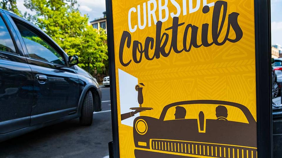 A sign juxtaposes driving with the dangers of drinking.