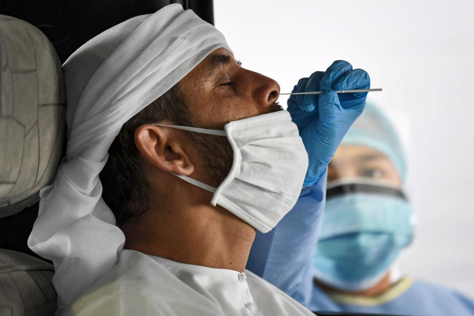 Health worker performs nasal swab PCR Covid-19 test Dubai Emirates
