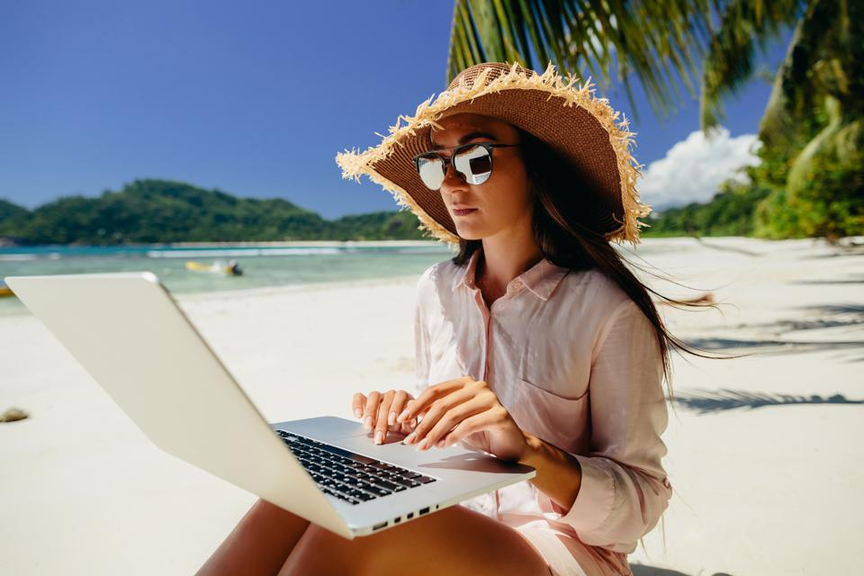 Woman freelancer on the beach