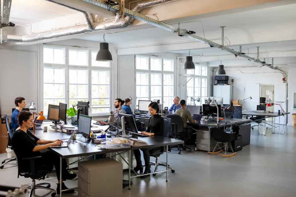 Busy modern open plan office with staff