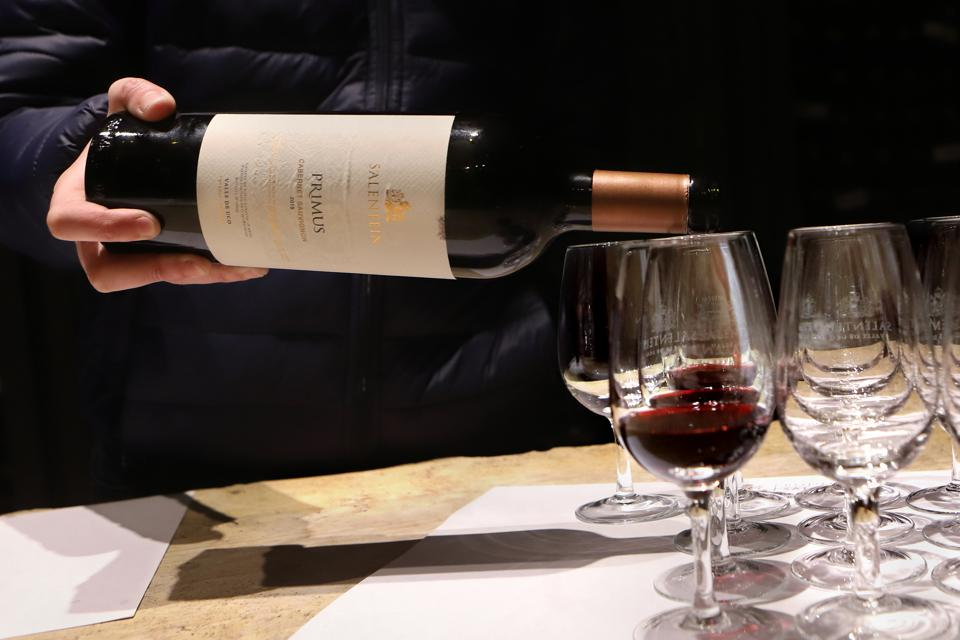 Wine being poured into a glass in Mendoza, Argentina.