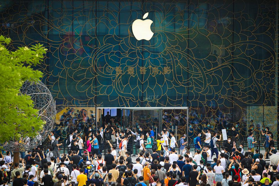 People queue outside Apple's new flagship store at Sanlitun on July 17 in Beijing, China.
