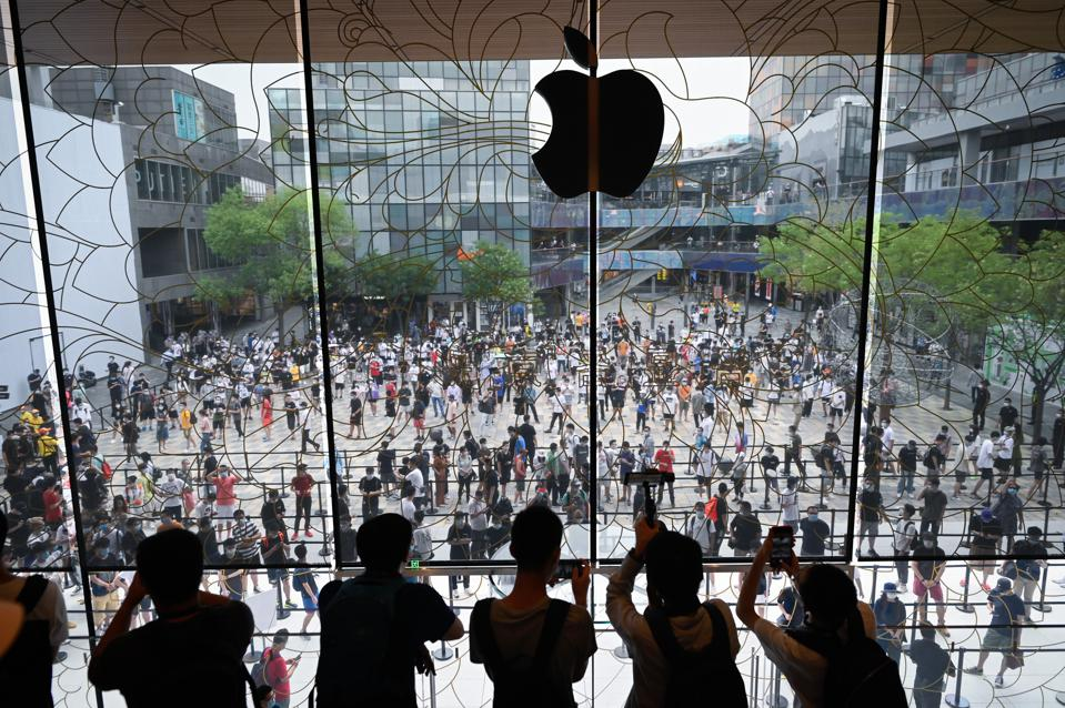 People queue up to enter the new Apple flagship store in Beijing on July 17, 2020.