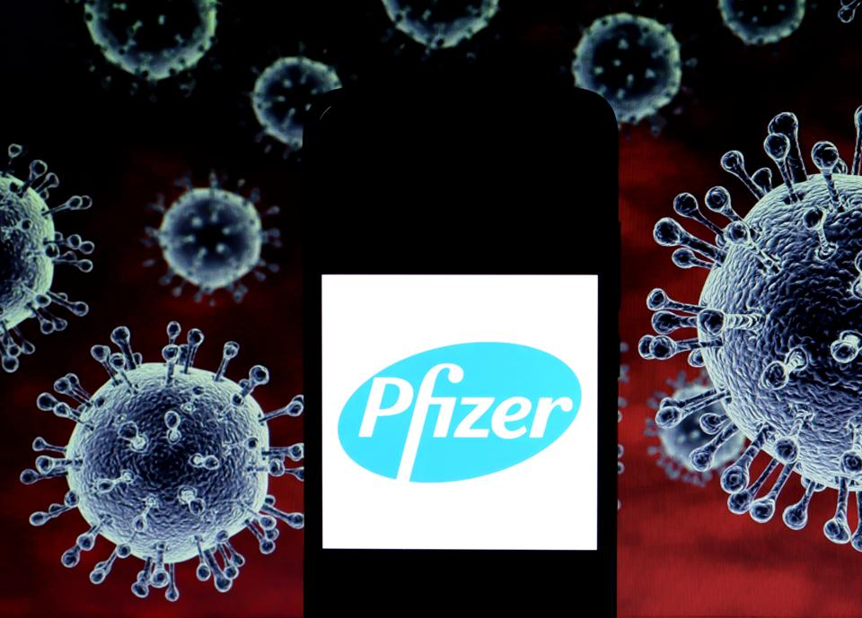 In this Photo illustration a logo of Pfizer seen displayed...