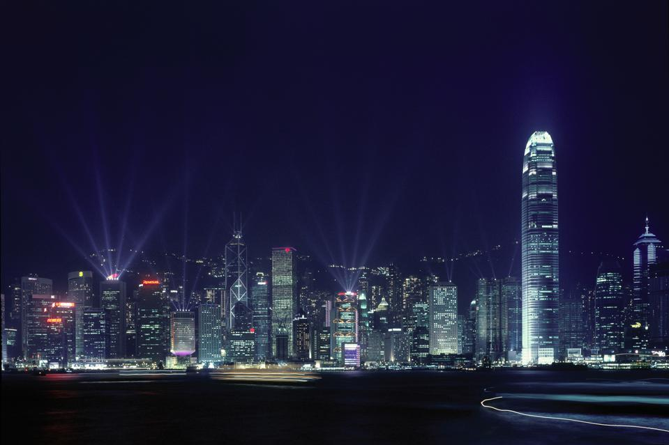 Hong Kong's skyline and Victoria Harbour during the and quot; Symphonie of Light and quot; multimedia show to promote tourism. April 3, 2004. Photographer: Grischa Rueschendorf/ Bloomberg News
