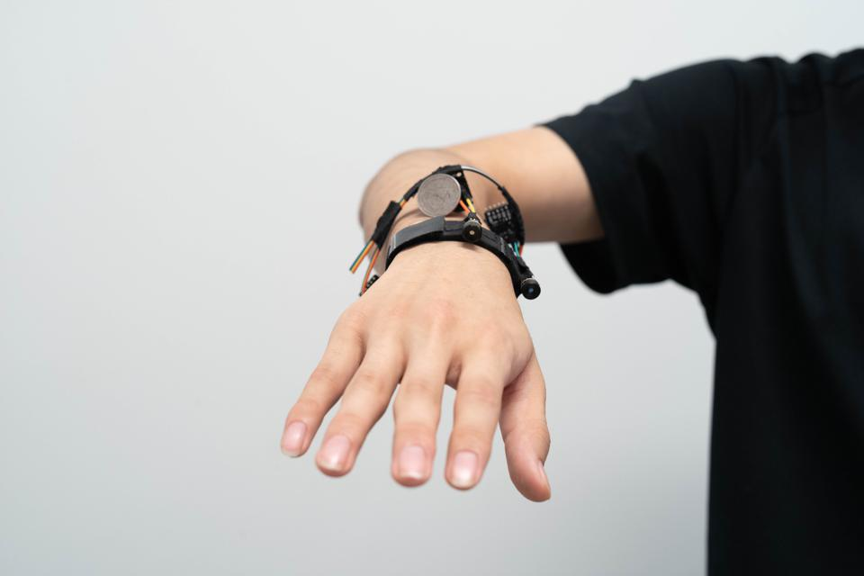 FingerTrak prototype bracelet for continuously tracking 3D hand movements.