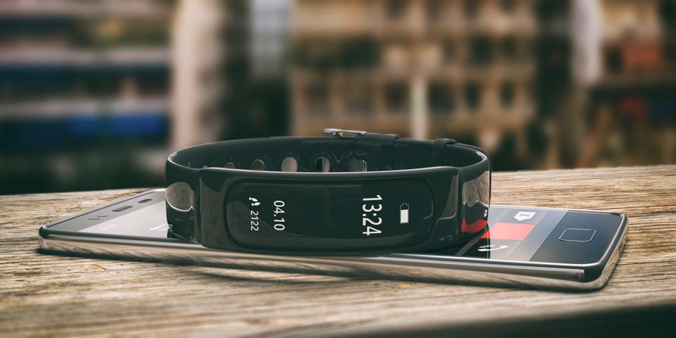 Fitness tracker, smart watch and mobile phone on wooden desk, blur background. 3d illustration