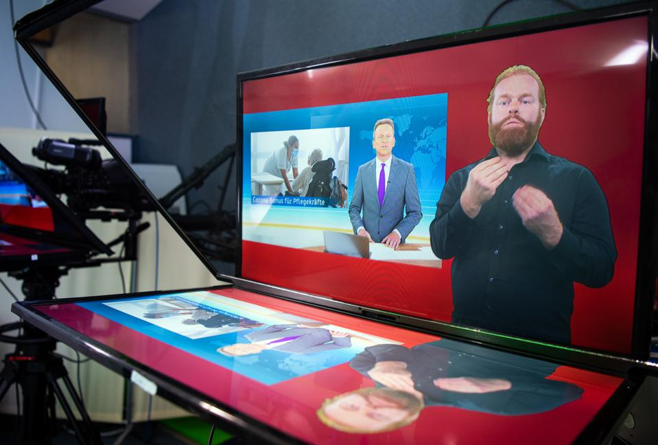 Sign-language translation of the news in TV studio in Germany