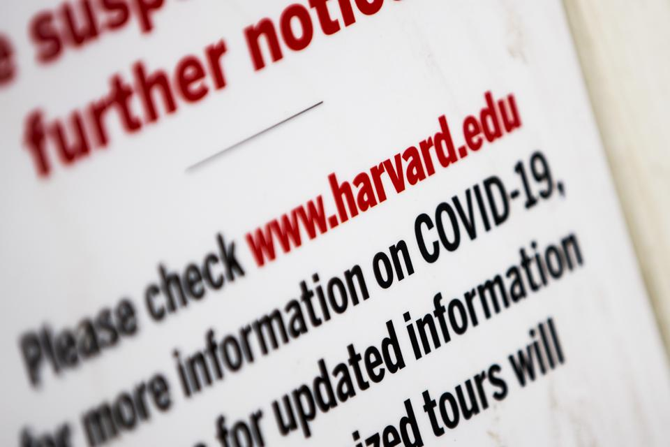 A sign informs people that tours are canceled at Harvard University in Cambridge, MA.