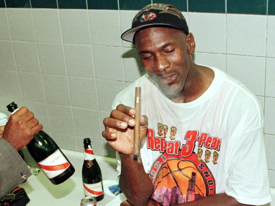 Michael Jordan of the Chicago Bulls enjoys a cigar