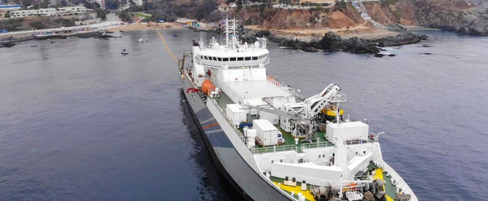 SubCom ship laying cable at sea