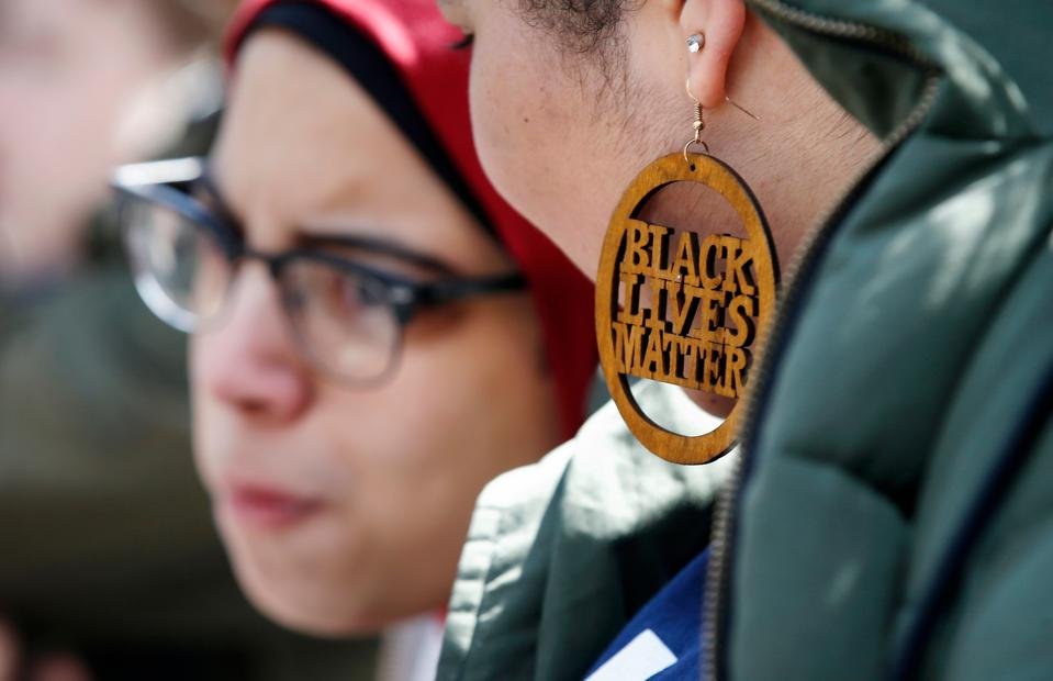 Harvard University student Cecilia Nunez wears a Black Lives Matter earring during a rally