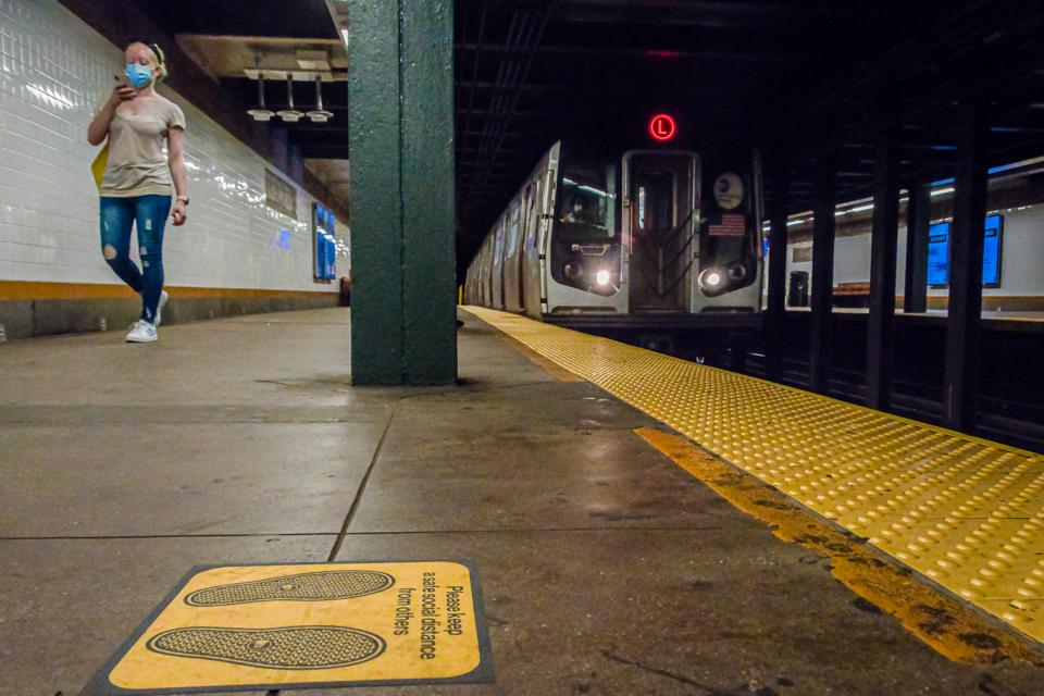 SIgns put on the floor for subway riders to mantain safe...