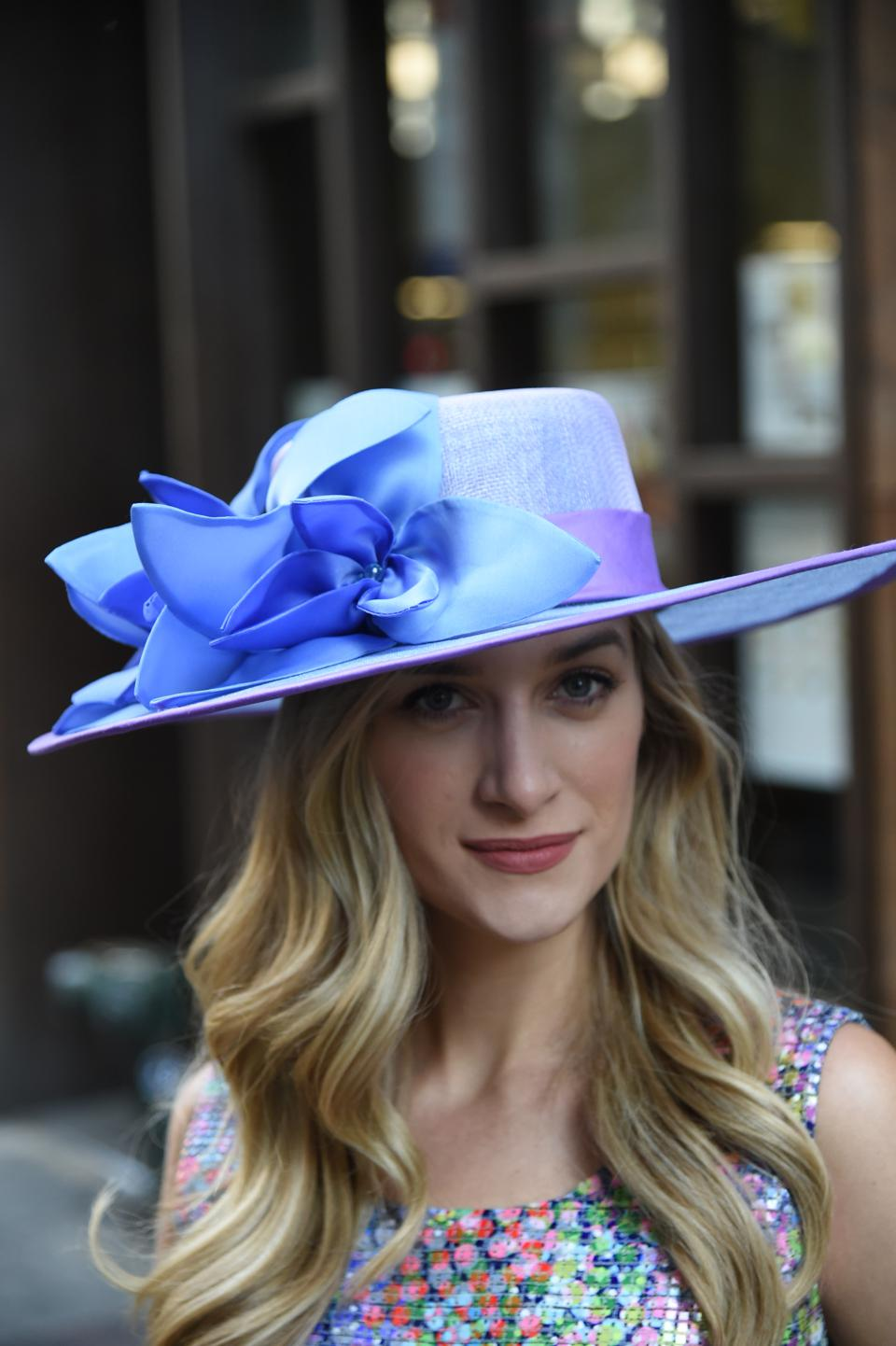 Hand blocked, silk taffeta bound, 3 layered sinamay broad brim boater accented with pointed petal flowers and embellished with beaded centers.