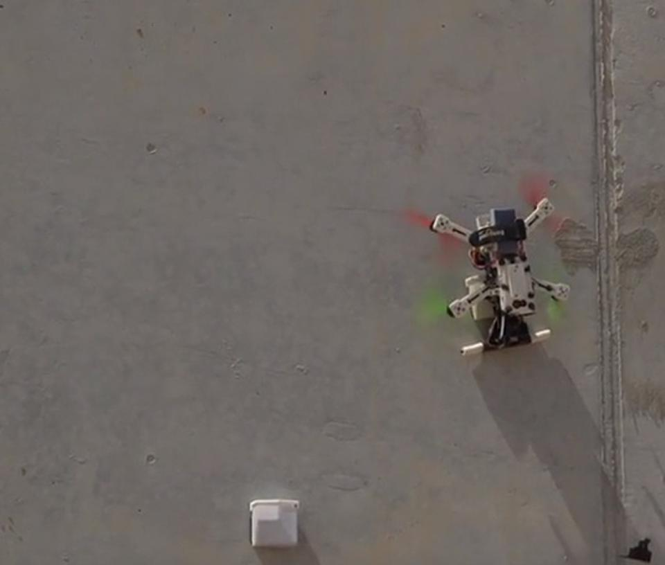 A drone stuck to a wall