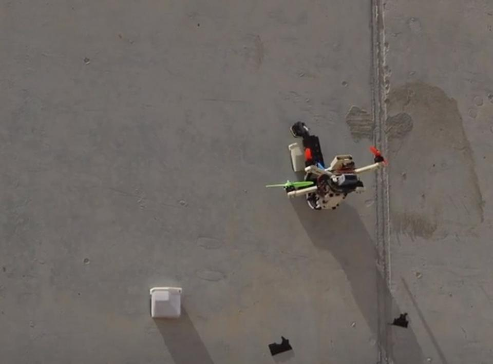 A drone sticking to a wall
