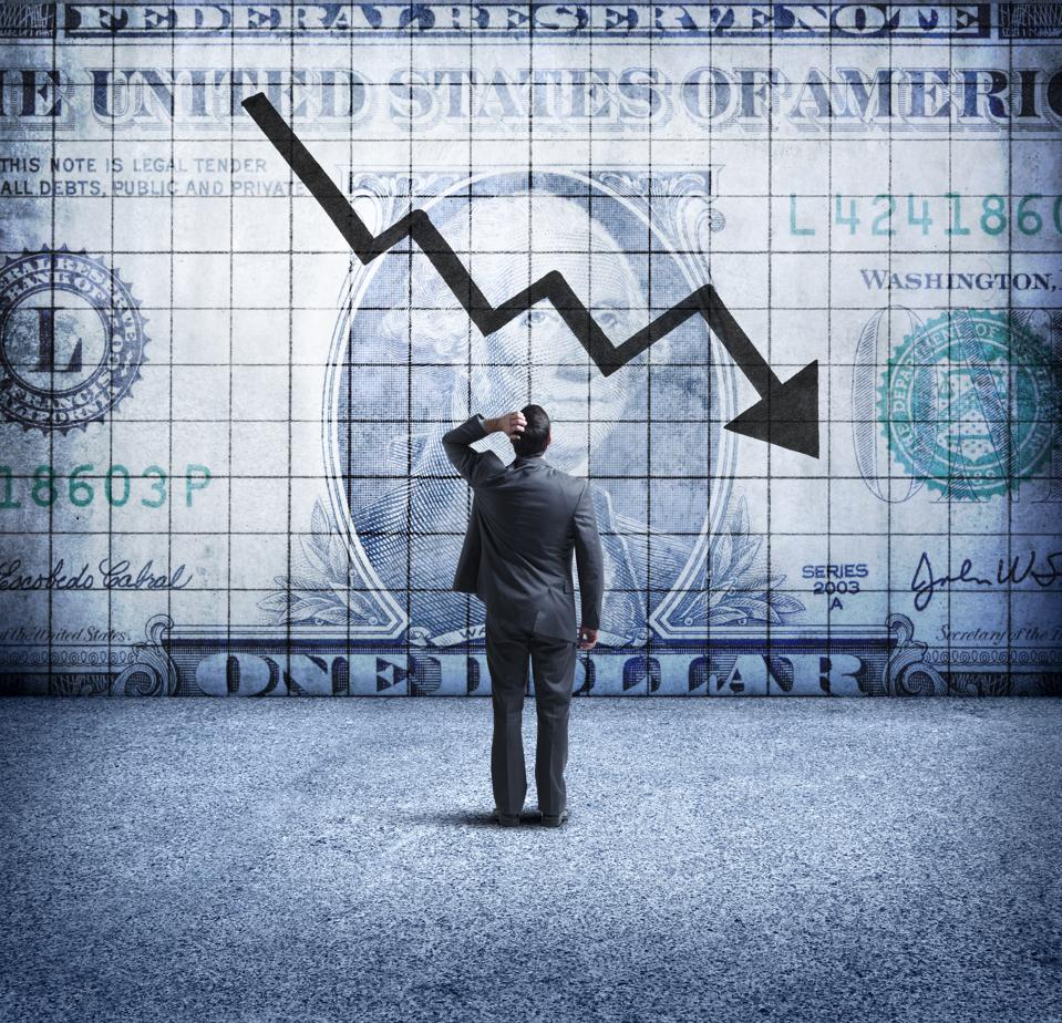 Infosnips Businessman Looking Up At a Chart That Indicates A Falling U.S. Dollar