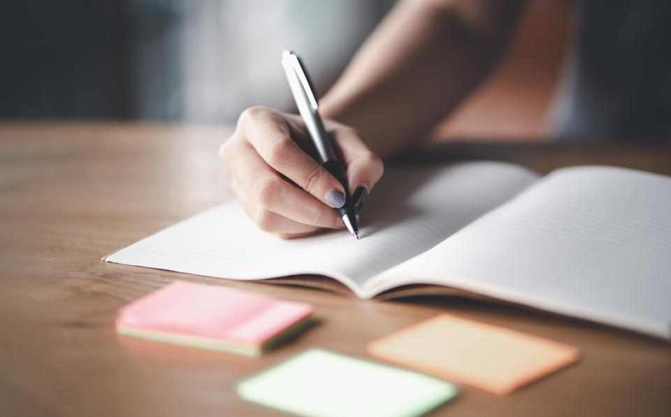 Business woman working at office with documents on his desk, Business woman holding pens and papers making notes in documents on the table, Hands of financial manager taking notes