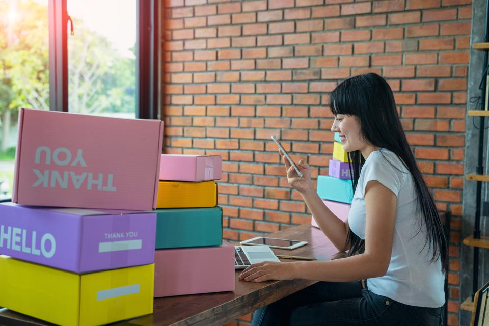 Asian teenager owner business woman work at home for online shopping