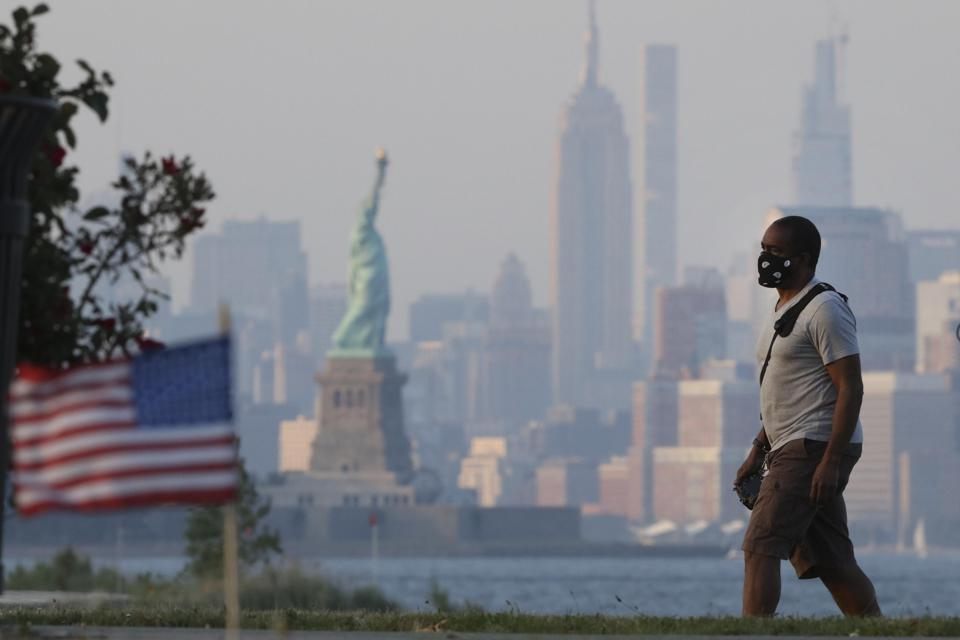 American Man in mask walks in New York on Independence Day 2020 In U.S.