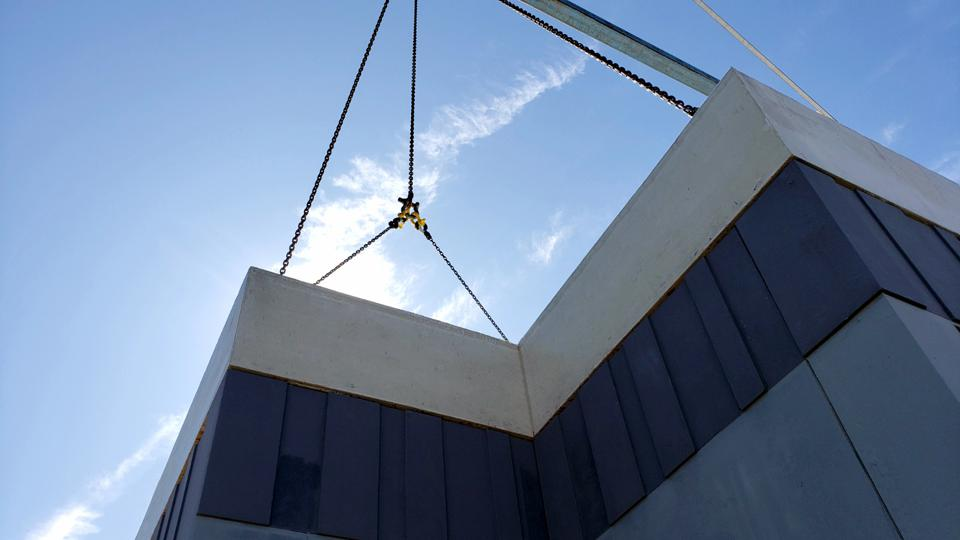 an upward view of a building being constructed using Nexiite from Nexii