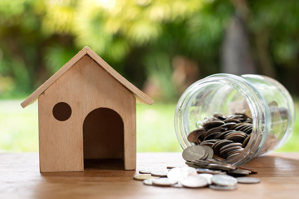 Home model with coin money stack, Saving money concept. Home buying.