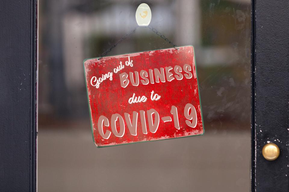 Red ″closed″ sign reading ″Going out of business due to Covid-19″.