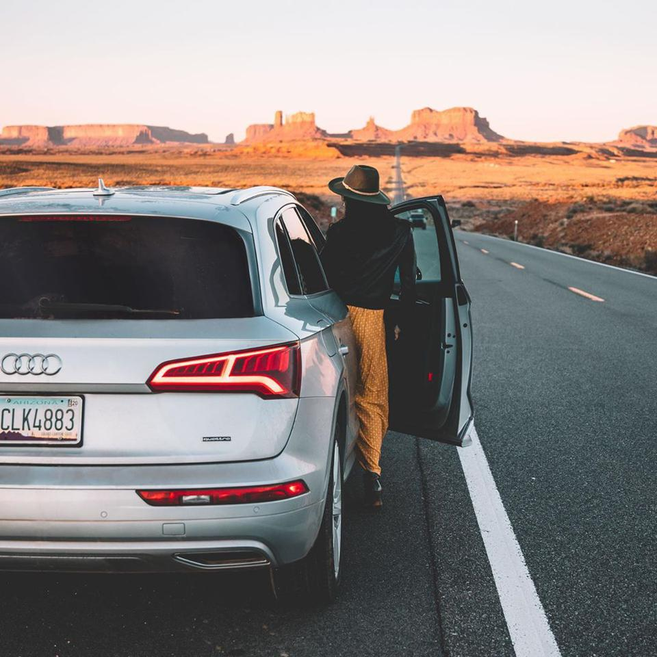 Woman gets into Silvercar's Audi Q7 SUV on the open road.