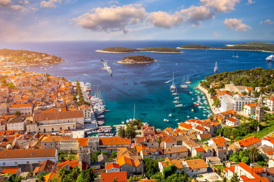 Amazing historic town of Hvar aerial view, Dalmatia, Croatia. Island of Hvar bay aerial view, Dalmatia, Croatia. Harbor of old Adriatic island town Hvar. Popular touristic destination of Croatia.