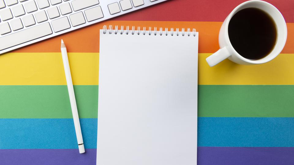 You could talk about pronouns at work by adding them into your bios and email signatures