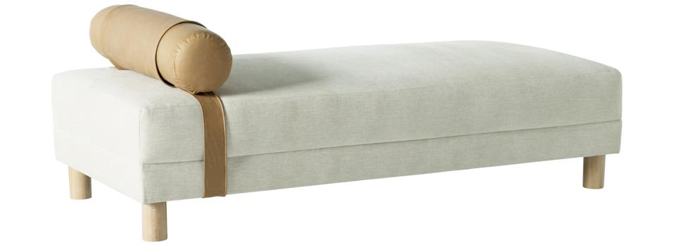Vaughn Grey Settee from Nate and Jeremiah for Living Spaces. Grey settee with wood legs and leather pillow