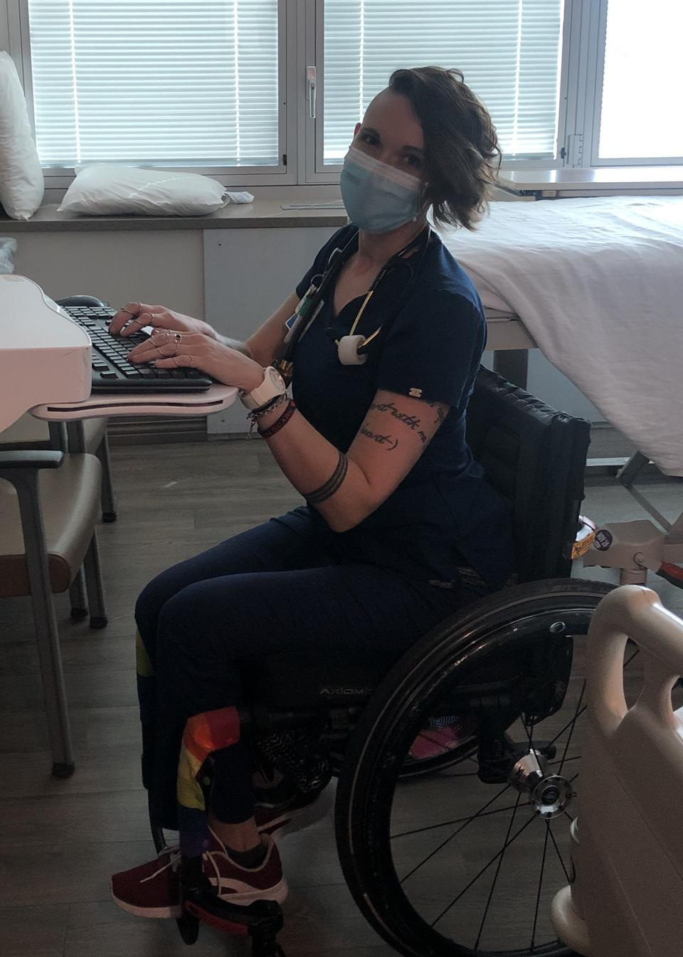 Ryann Kress, a nurse who uses a wheelchair, working in the hospital.