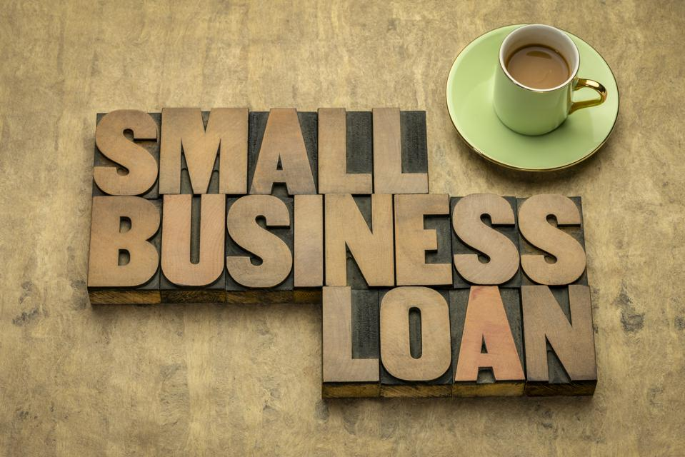 small business loan word abstract in wood type