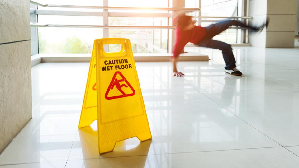 Man slips falling on wet floor