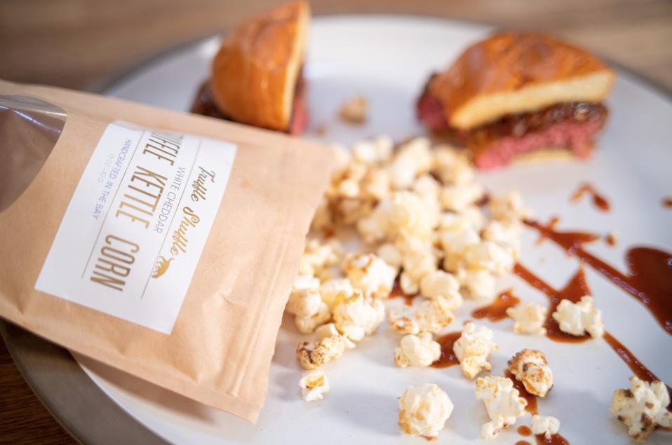 Truffle Shuffle Kettle Corn served with a sandwich