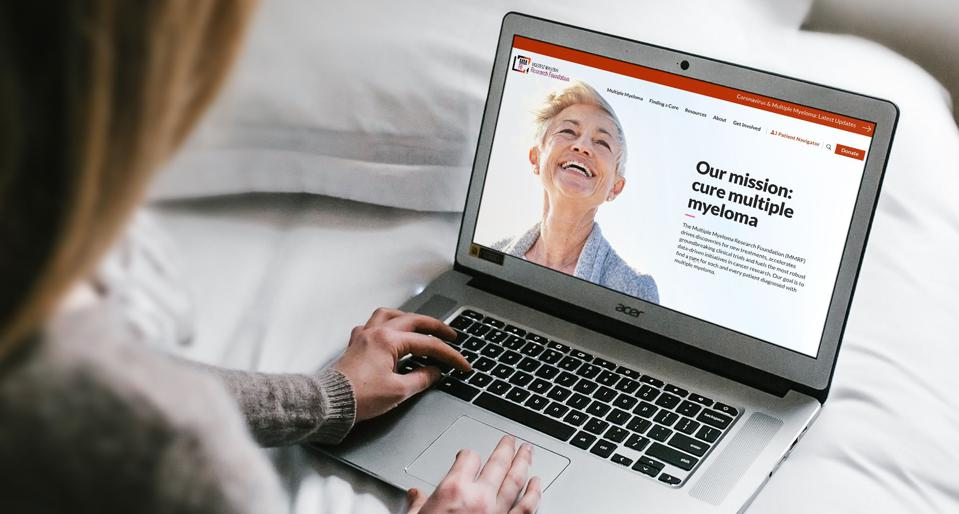 Woman on computer exploring the product for multiple myeloma patients.