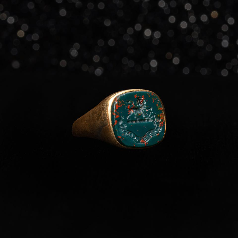 The Victorian Bloodstone Hope Intaglio Ring dates back to 1851 and is made of 18k Gold & Bloodstone Itaglio. Carved with a Lion and Anchor above a banner reading ″Dum Spe Calerant″ which roughly translates to ″While They Were Warm with Hope″.