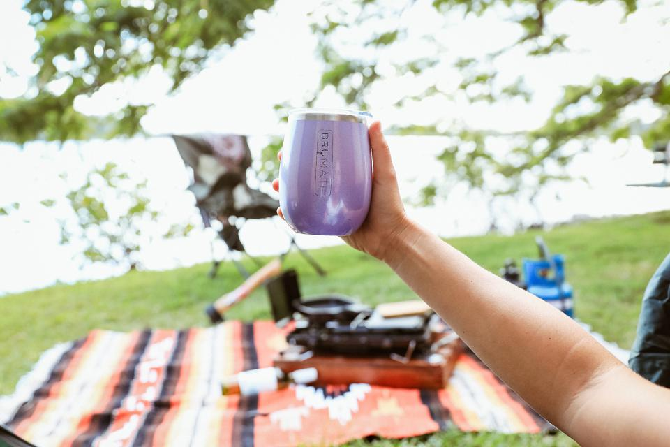 Person holding a purple tumbler.