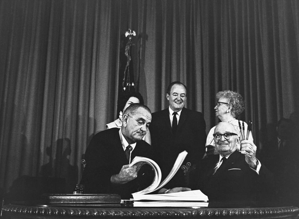 President Johnson Signs Medicare Bill With Harry Truman