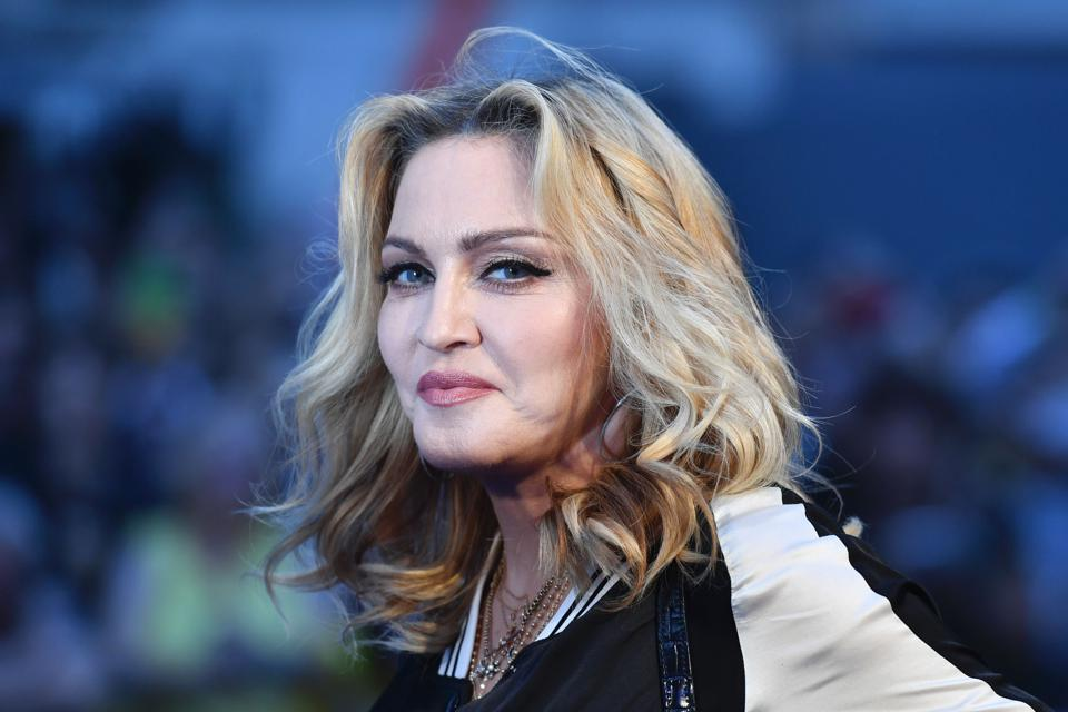 US singer-songwriter Madonna poses arriving on the carpet to attend a special screening of the film The Beatles Eight Days A Week: The Touring Years in London on September 15, 2016.