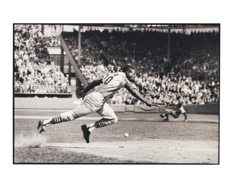 Photograph of Lou Brock running towards a base