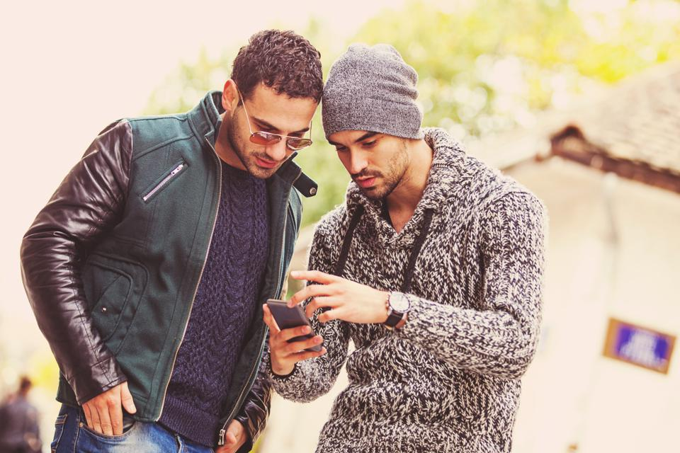 Two young men looking at a smartphone