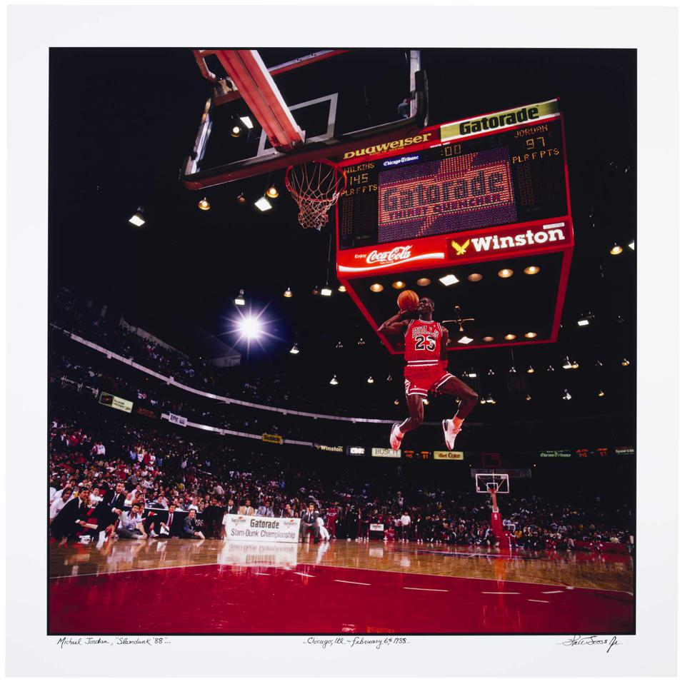 Michael Jordan in mid air about to make a slam dunk