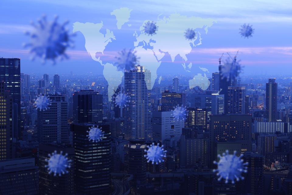 Images of a virus superimposed on skyscrapers and a map of the world