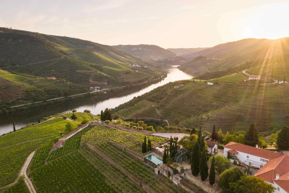 The sun sets over the Douro Valley and the Quinta Nova winery in Portugal