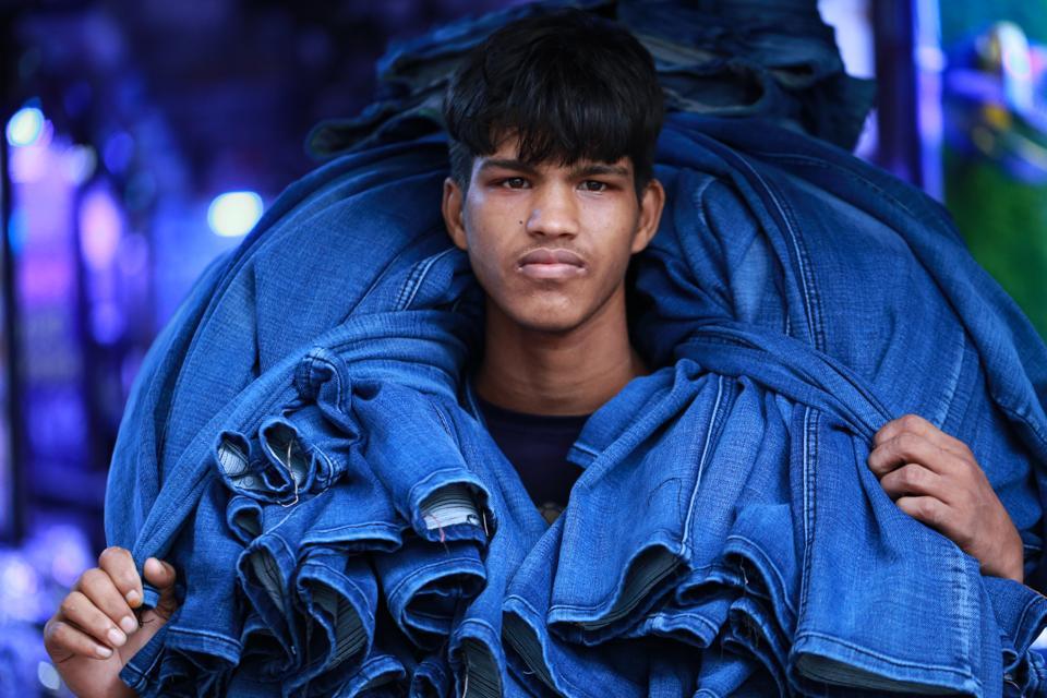 Daily Life In Dhaka During Coronavirus Pandemic garment worker