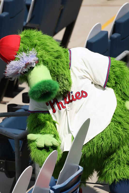The Phillie Phanatic interacts with fan cutouts.