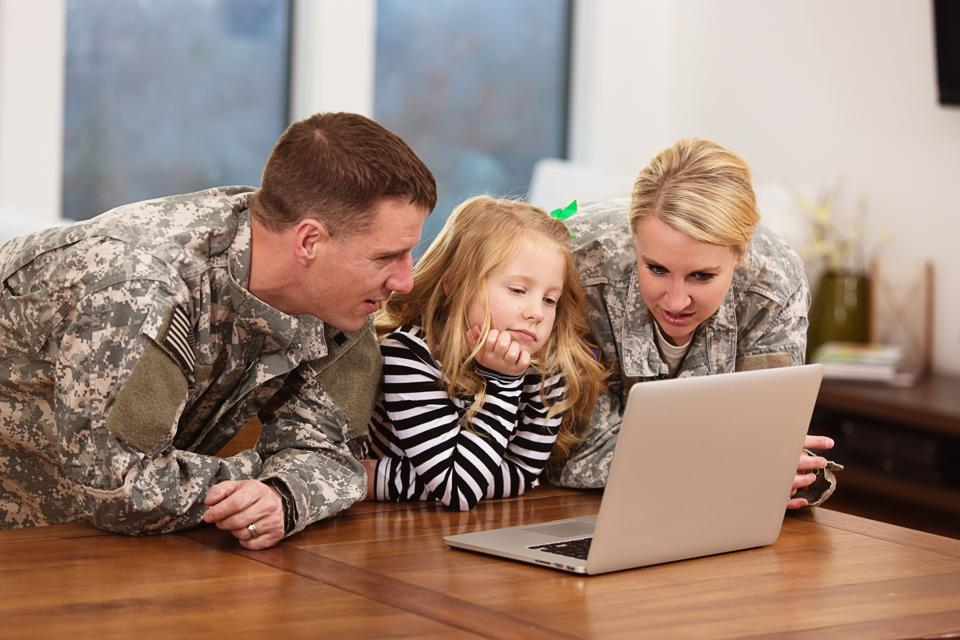 Military family looking at a laptop