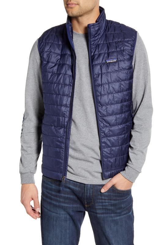 Patagonia nano puff vest in navy on model