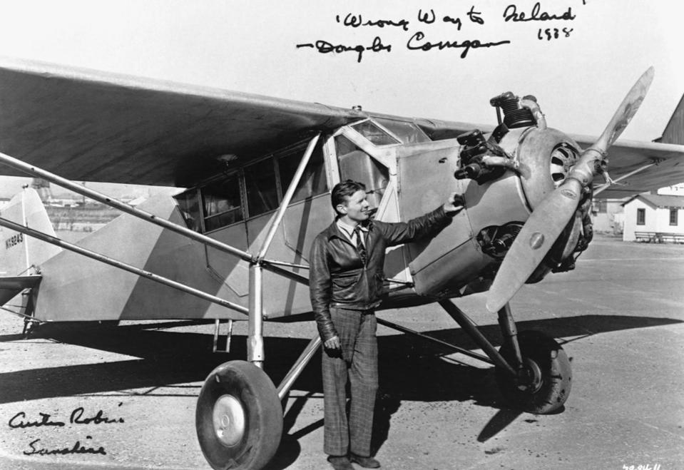 Douglas ″Wrong-Way″ Corrigan Next to Curtiss Robin J-1 Touring Plane
